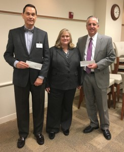Christian Hospital President Ron McMullen and SSM DePaul President Sean Hogan receive Mallinckrodt grant funding for their CHAP programs from NCI President Rebecca Zoll.