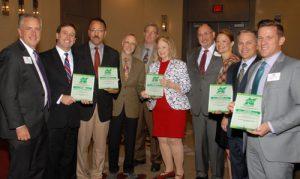 NCI Board Chair Sean Hogan presents Business Development Award to Great Streets-Natural Bridge Corridor Partnership