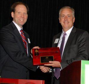 2016 Chair Sean Hogan thanks 2015 Board Chair Dan Boyle for his service to NCI