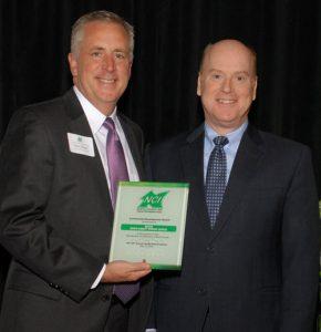 NCI Board Chair Sean Hogan presents Metro's John Nations with Community Development Award