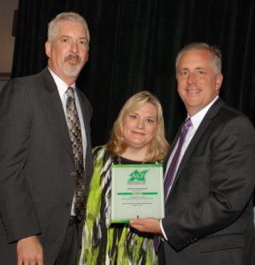 NCI Board Chair Sean Hogan presents Doug Baum with Public Service Award