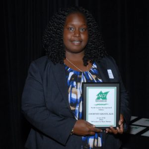 courtney-graves-30-leader-holding-award