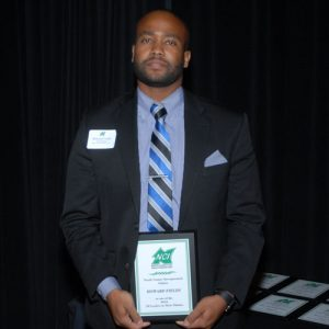 howard-fields-30-leader-holding-award