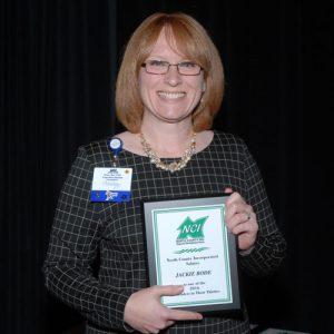 jackie-bode-30-leader-holding-award