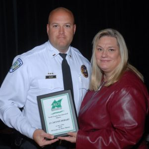 Lt. Dennis Dehart of the Florissant Police Department Receiving Award from President/CEO of NCI Rebecca Zoll